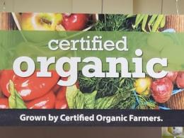 Organic produce ad at a chain grocery store. Who's buying?