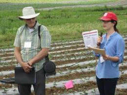 Andrea Leiva Soto with her advisor, Dr. Doug Doohan, highlighting key findings and facilitating discussion with participants on an organic vegetable on-farm trial. Photo Credit: Stephanie Short